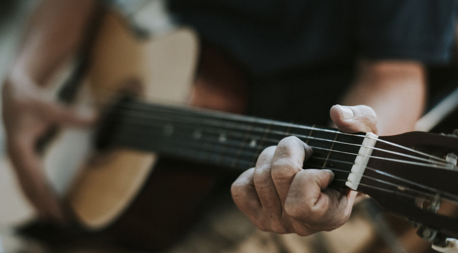 Man playing guitar for therapy